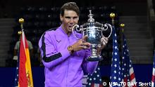Sept 8, 2019; Flushing, NY, USA; Rafael Nadal of Spain celebrates with the championship trophy after beating Daniil Medvedev of Russia in the men's singles final on day fourteen of the 2019 U.S. Open tennis tournament at USTA Billie Jean King National Tennis Center. Mandatory Credit: Robert Deutsch-USA TODAY Sports