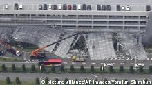 An aerial photo shows damaged temporary scaffold set outside of a parking building at Haneda Airport in Tokyo on Sep 9, 2019. Typhoon No. 15, Typhoon Faxai , landed near Chiba City, Chiba prefecture at about 5 a.m. on the same day. ( The Yomiuri Shimbun via AP Images ) |