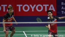 Indonesia's Marcus Fernaldi Gideon (L) watches partner Kevin Sanjaya Sukamuljo play a shot against Japan's Hiroyuki Endo and Yuta Watanabe during their men's doubles quarter-final match at the Thailand Open Badminton tournament in Bangkok on August 2, 2019. (Photo by Chalinee Thirasupa / AFP) (Photo credit should read CHALINEE THIRASUPA/AFP/Getty Images)