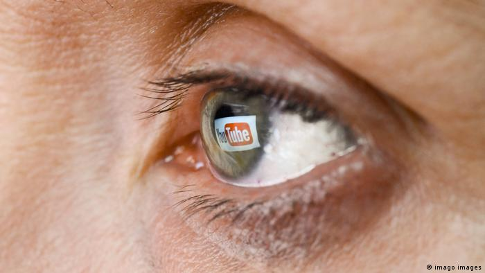 YouTube logo reflected in an eye