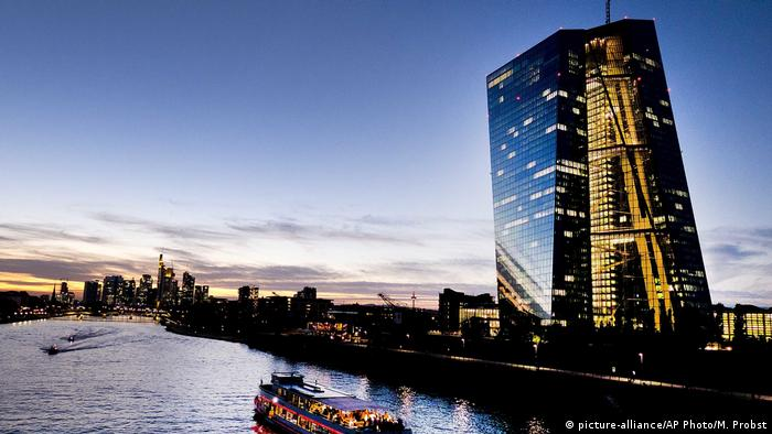 A party ship on the river Main passes the European Central Bank in Frankfurt, Germany