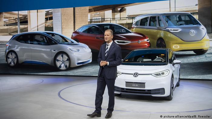 Volkswagen CEO Herbert Diess stands in front of an ID.3