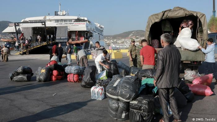 A group of refugees preparing to board a boat