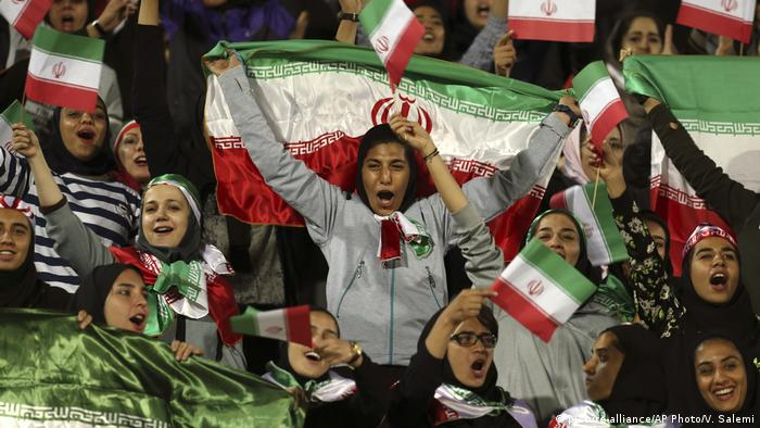 Iranian women cheer at a friendly soccer match between Iran and Bolivia in Tehran in October 2018