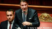 Italy's Prime Minister Giuseppe Conte (C) delivers a speech as Italy's Foreign Minister Luigi Di Maio looks on during the new government's confidence vote on September 10, 2019 at the Senate in Rome. - Italian Prime Minister Giuseppe Conte called on September 9 for the reform of European Union budget rules and cooperation on immigration as his new government won a parliamentary confidence vote at the lower house. (Photo by Filippo MONTEFORTE / AFP) (Photo credit should read FILIPPO MONTEFORTE/AFP/Getty Images)