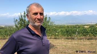 Georgian winemaker poses for a picture in his vineyard in Georgia's eastern Kakheti region.