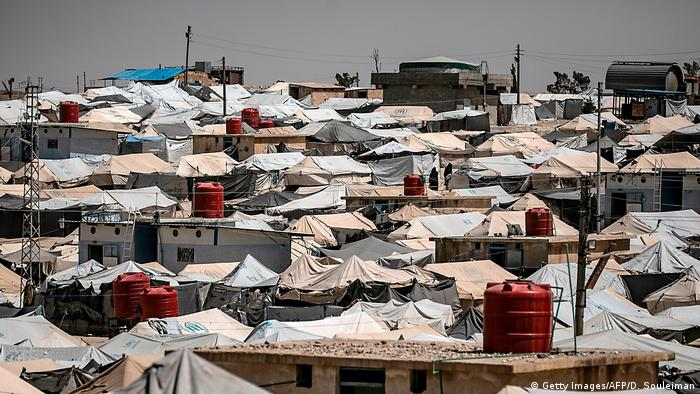 Photo that shows the tops of tents and roofs of buildings cramped together