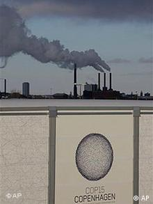 A power plant is seen behind Bella Center, the venue of the UN climate conference, in Copenhagen
