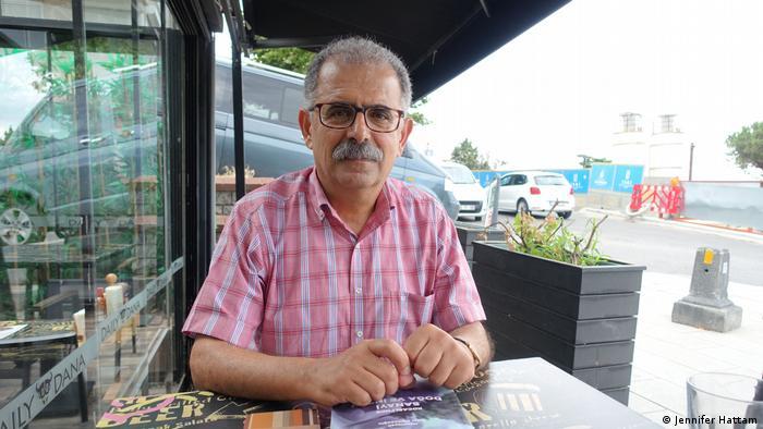 Prof. Dr. Onur Hamzaoðlu sit outside at a cafe in Turkey