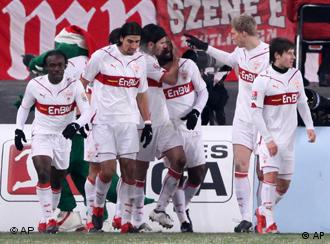 The players from Stuttgart celebrate scorer Cacau, center, during the German first division Bundesliga soccer match between VfB Stuttgart and TSG 1899 Hoffenheim in Stuttgart, Germany, on Saturday, Dec. 19, 2009.