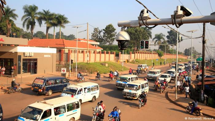 Surveillance camera hanging over a busy road in Kampala