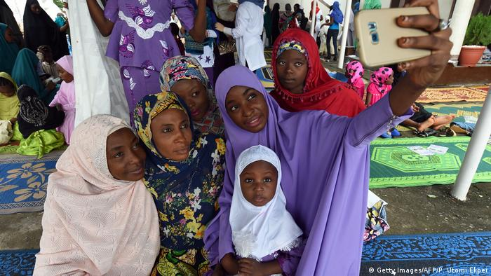 A group of women and children take a selfie in Nigeria