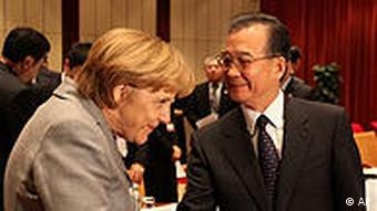 German Chancellor Angela Merkel shakes hand with China's prime minister Wen Jiabao during the UN Climate Summit in Copenhagen