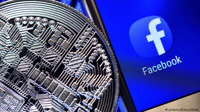 A generic picture showing Facebook's logo on a smartphone next to a imaginary digital coin