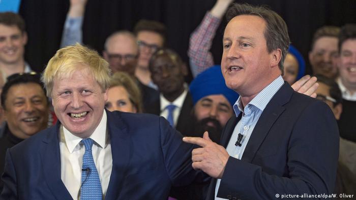 British Prime Minister Boris Johnson (L) and former Prime Minister David Cameron