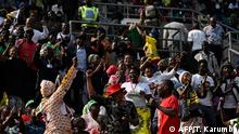 People wait at the National Sports stadium where the official funeral for Robert Mugabe is to be held in Harare, on September 14, 2019. - Former Zimbabwe leader Robert Mugabe will be given a state funeral on September 14, 2019 with a dozen African leaders expected to pay tribute to a man lauded as a colonial-era liberation hero. Mugabe, who died last week in Singapore aged 95, left Zimbabwe torn over the legacy of his 37-year rule marked by brutal repression and economic crisis. (Photo by Tony Karumba / AFP)