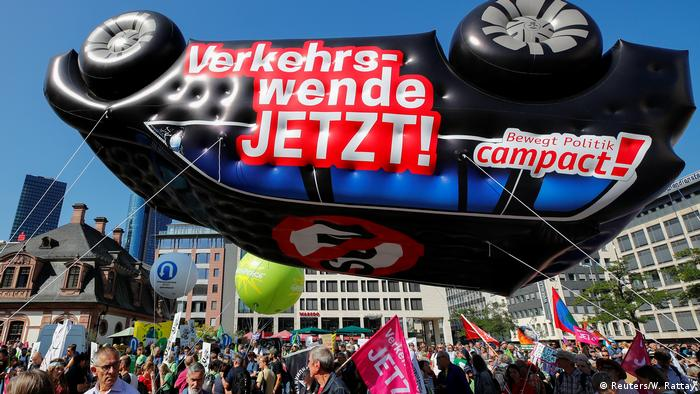 Protestors gather outside the Frankfurt exhibition hall with a car-shaped balloon (Reuters/W. Rattay)