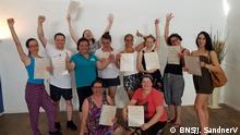 Köln | Syani Justina und ihre Schüler von der Massageschule (BNS/J. SandnerV)