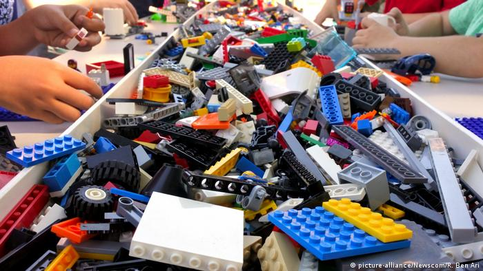 Kids play with plastic Legos