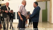 Ai Weiwei talking with Bernhard Spies, managing director of the museum (picture-alliance/dpa/Ai Weiwei Studio/M. Logsdail)