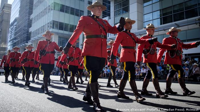 Members of the Royal Canadian Mounted Police march during the Calgary Stampede parade in Calgary.