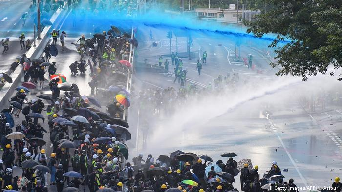 Hong Kong police fired dyed water and tear gas at protesters