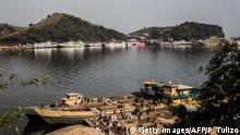 A picture taken on August 1, 2019 shows a general view of ships linking Goma and Bukavu on Lake Kivu, moored at the port in Goma, eastern DR Congo. - Rwanda has shuttered its frontier with Ebola-hit Democratic Republic of Congo after a third case of the deadly virus was detected in the border city of Goma, the Congolese presidency said on August 1, 2019. (Photo by PAMELA TULIZO / AFP) (Photo credit should read PAMELA TULIZO/AFP/Getty Images)
