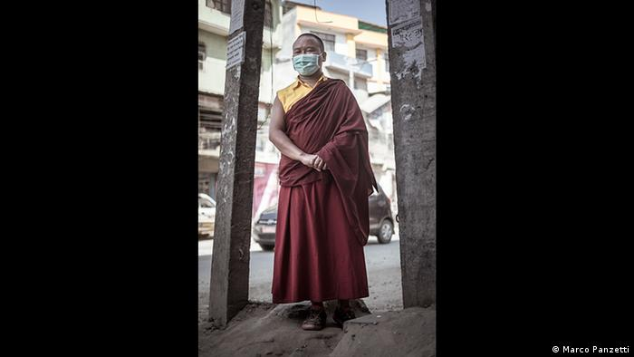 Buddhist monk wearing facemask against air pollution in Kathmandu, Nepal