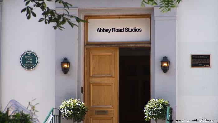 Entrance to the Abbey Road Studios, with a wooden door open
