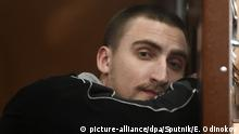12.09.2019, Russland, Moskau: 6007395 12.09.2019 Pavel Ustinov, who is accused of injuring a member Russian National Guard during the rally in the city center on August 3, waits in a court room at Moscow's Tverskoy court, Russia. Eugene Odinokov / Sputnik Foto: Eugene Odinokov/Sputnik/dpa  
