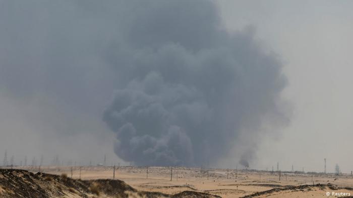 A Saudi Aramco oil plant burns after a strike