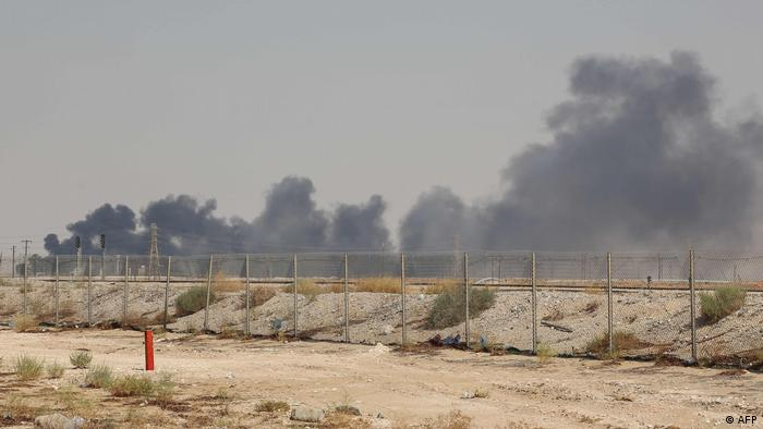 Smoke billows from an Aramco oil facility in Abquaiq following drone attacks