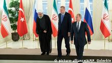 16.09.2019 *** From left, Iranian President Hassan Rouhani, Turkish President Recep Tayyip Erdogan and Russian President Vladimir Putin after posing for a photo in Ankara, Turkey, Monday, Sept. 16, 2019. The leaders of Russia, Iran and Turkey met in Ankara to discuss the situation in Syria, with the aim of halting fighting in the northwestern Idlib province and finding a lasting political solution to the country's civil war, now in its ninth year. (AP Photo/Pavel Golovkin, Pool)