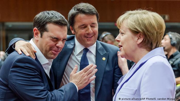 Matteo Renzi (center) wraps his arm around Alexis Tsipras while standing next to German Chancellor Angela Merkel