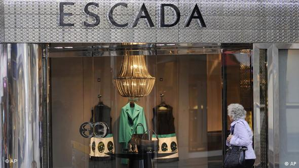 Shoppers pass by an Escada window