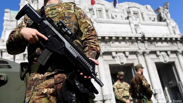 Soldier guarding the scene of Milan stabbing (Reuters/F. Lo Scalzo)