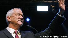 Benny Gantz, leader and candidate of the Israel Resilience party that is part of the Blue and White (Kahol Lavan) political alliance, waves as he addresses supporters at the alliance's campaign headquarters in the Israeli coastal city of Tel Aviv early on September 18, 2019. - Benny Gantz, the main challenger to Israeli Prime Minister Benjamin Netanyahu in the country's general election, called for a broad unity government as exit surveys showed a tight race. We will act to form a broad unity government that will express the will of the people, Gantz told supporters at a post-election rally in Tel Aviv. He however cautioned that he was waiting for final results. (Photo by GALI TIBBON / AFP) (Photo credit should read GALI TIBBON/AFP/Getty Images)