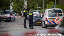 Police officers control the access near the site of a shooting on September 18, 2019 in the Amsterdam district of Buitenveldert, where Dutch lawyer Derk Wiersum was shot dead. (Getty Images/AFP/M. Van Bergen)