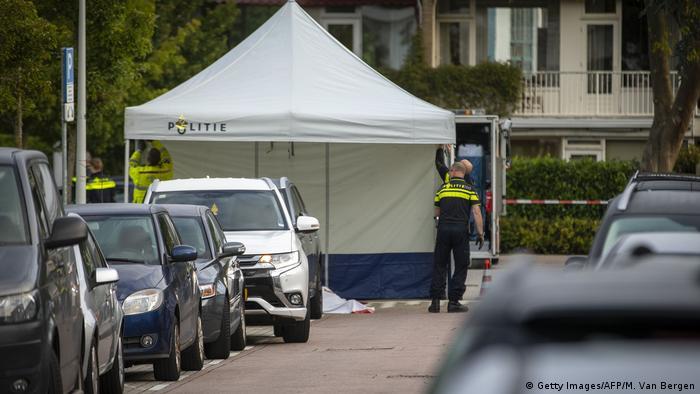 Policemen work on September 18, 2019, at the site of a shooting in the Amsterdam district of Buitenveldert, where Dutch lawyer Derk Wiersum was shot dead. (Getty Images/AFP/M. Van Bergen)