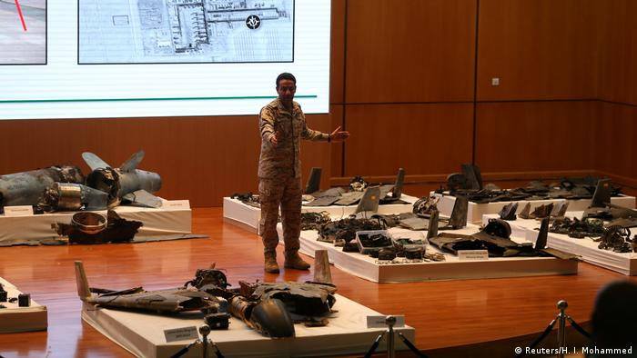 Saudi defense ministry spokesman Colonel Turki Al-Malik displays remains of the missiles which Saudi government says were used to attack an Aramco oil facility