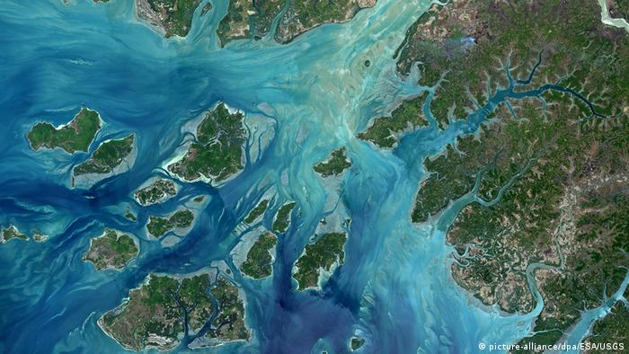 A satellite image of land, islands and mudflats