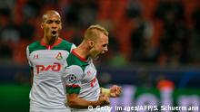 Lokomotiv Moscow's Russian midfielder Dmitriy Barinov celebrates scoring with his team-mates during the UEFA Champions League Group D football match between Bayer Leverkusen and Lokomotiv Moscow in Leverkusen, western Germany, on September 18, 2019. (Photo by SASCHA SCHUERMANN / AFP) (Photo credit should read SASCHA SCHUERMANN/AFP/Getty Images)