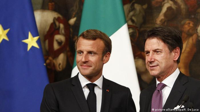 Giuseppe Conte and Emmanuel Macron talk migration in Rome