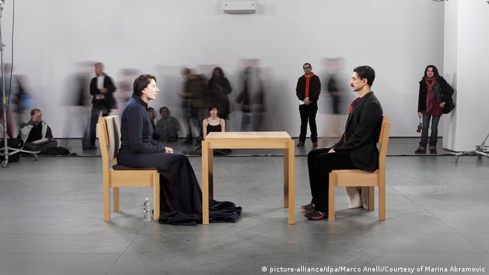 Marina Abramovic sits across from another man in The Artist is Present