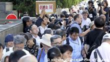 People head for the trial of the rendition of judgment on TEPCO former executives in front of the Tokyo District Court in Tokyo on Sep. 19, 2019. Tsunehisa Katsumata, former chairman of Tokyo Electric Power Company Holdings Inc.(TEPCO), Sakae Muto, former vice president, and Ichiro Takekuro, former vice president, were charged with professional negligence resulting in death and injury in connection with the Fukushima No.1 Power Plant nuclear accident caused by tsunami that struck the plant following a powerful earthquake on March 11, 2011. They found innocent of a crime. ( The Yomiuri Shimbun via AP Images ) |