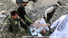 An Afghan security member and people carry an injured man after a suicide attack in Zabul, Afghanistan, Thursday, Sept. 19, 2019. A powerful early morning suicide truck bomb devastated a hospital in southern Afghanistan on Thursday. (AP Photo/Ahmad Wali Sarhadi) |