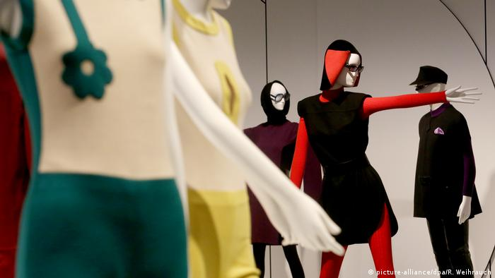 Three of Cardin's models displayed on mannequins