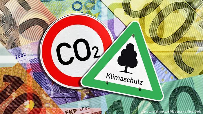 Банкноты евро и знаки-символы защиты климата