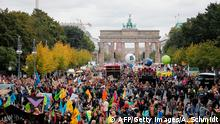 People take part in the Fridays for Future protest in front of the Brandenburg Gate in Berlin as a protest for climate action on September 20, 2019, as part of a global climate action day. (Photo by AXEL SCHMIDT / AFP) (Photo credit should read AXEL SCHMIDT/AFP/Getty Images)