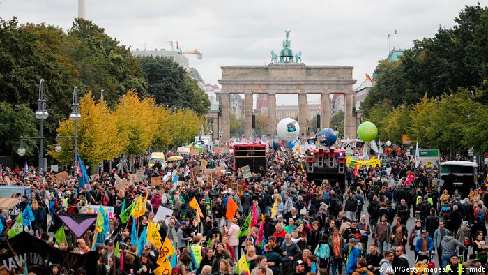 Thousands of protesters gather before the Brandenburg Gate in Berlin